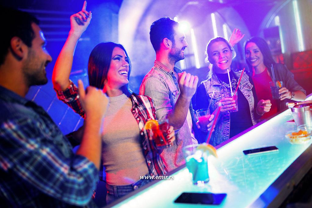 young cheerful people having fun in nightclub photo art studio