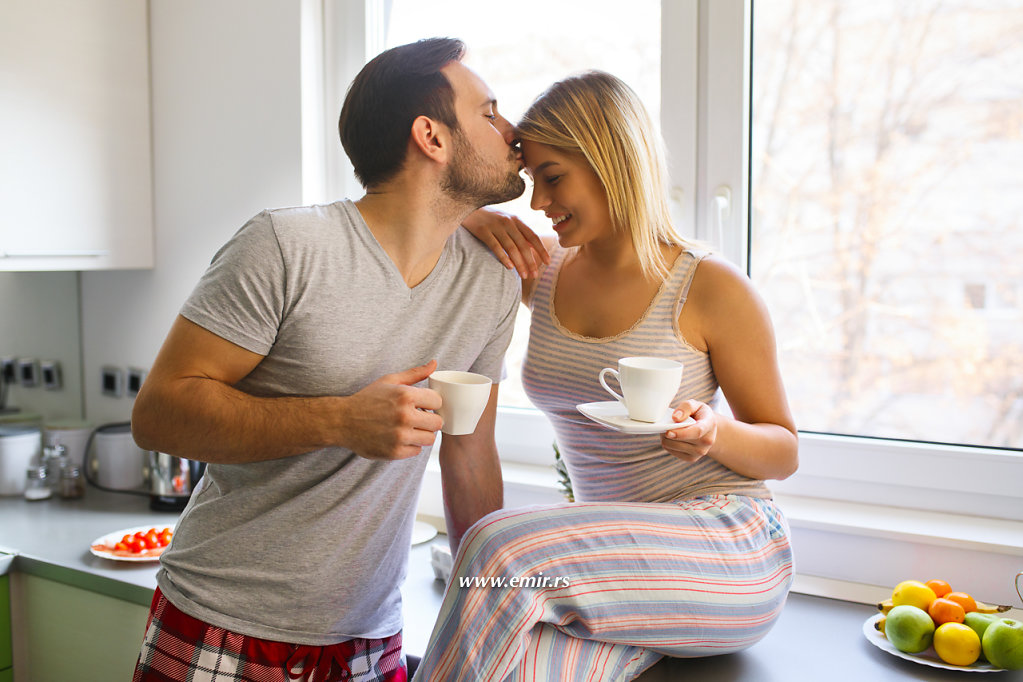 Romantic couple enjoying coffee and romance on weekend morning.