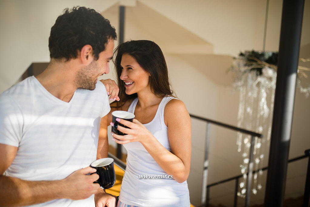 Affectionate couple enjoying  morning coffee and flirting